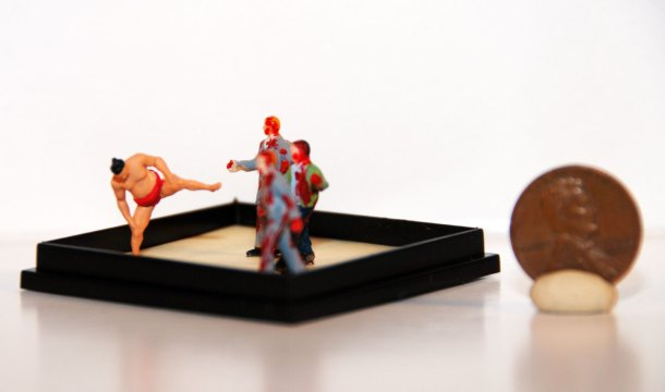 Who wins the fight of sumo versus zombie? Tiny zombie diorama by Michelle Merrywidow of ZombieHoedown