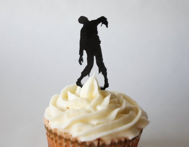 At least this zombie for your cupcake is more hygenic than most! Acrylic cupcake decoration by John Carney of ThroughThickandThin