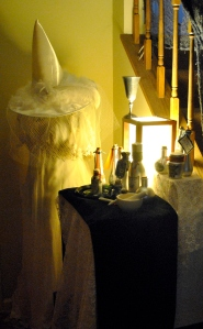 Potions on display with a white witch's wardrobe. Next year, I think she needs a good broom.
