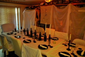 Another view of the table, with our very full bookcases covered in white curtains.