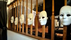 Strange faces great guests inside the door, backlit by tea lights.