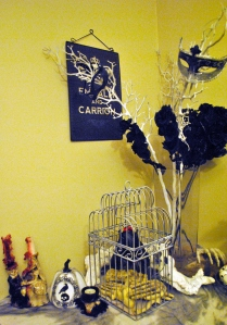 Floral arrangement with masks. Plus, the card cage from my wedding is now a bat cage.