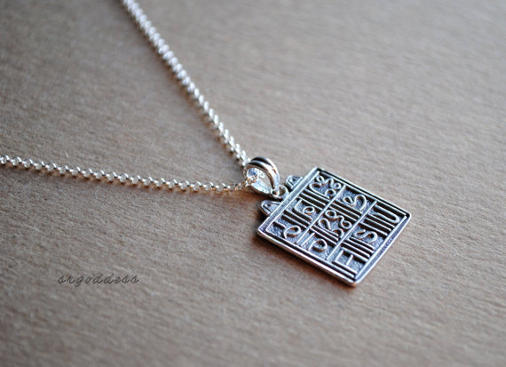 This magic square necklace by srgoddess is simple and mysterious.