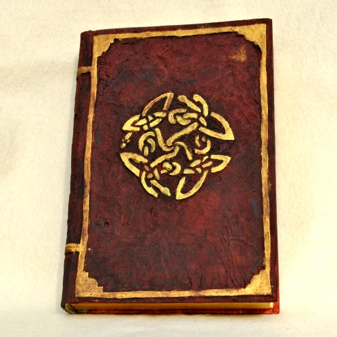 New fake leather cover on an ugly old book.