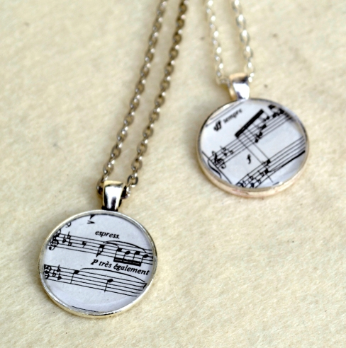 My upcycled sheet music necklaces have been really popular in the last year. These more affordable versions are in base metal instead of silver for the convention goers limited budget.