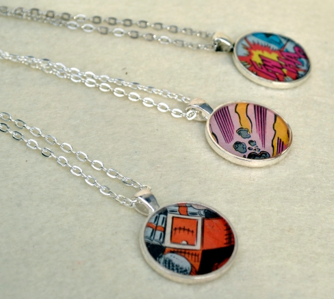 Bright and colorful pieces of old comic books look so vibrant in metal frames. So, new style of comic necklaces!