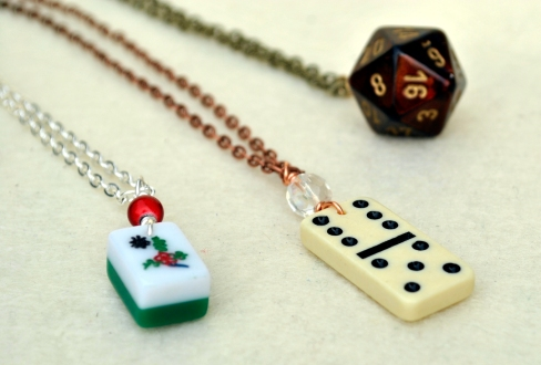 I've sold dice pendants for several years at conventions, but the simple addition of a chain really dressed them up. Plus, added some other game piece necklaces for those who are not roleplaying gamers.