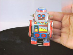 I love the look of old robots! This colorful little fella is a wind up toy, and is available at Urs Today.