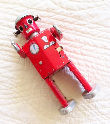 Olives and Doves has this wonderful bright red vintage robot toy. Isn't he charming?