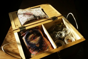 Divided into new compartments for tools, wire, and supplies. The lovely cloth pouches were a gift from my mother in law.
