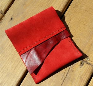 I came up with this little bag while playing with leather scraps. It was great stitching practice.